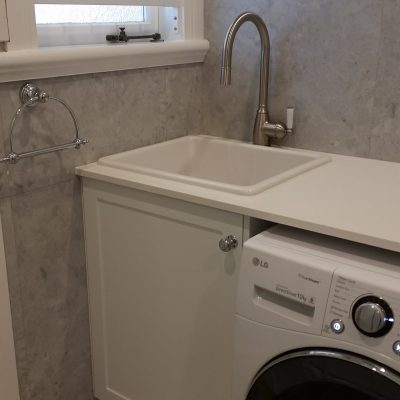 porcelain sink in laundry