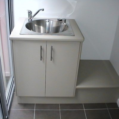 laundry with round tub
