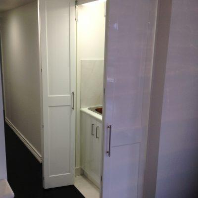 laundry behind bi-fold doors